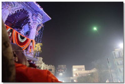 Acharya Swamishree watches the fireworks display