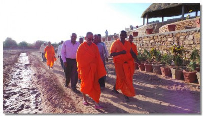 Acharya Swamishree inspects the transformation progress of the land into a garden