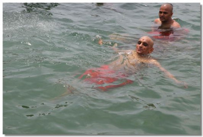 Acharya Swamishree swims in the large water tank pools