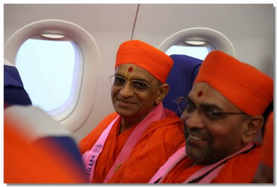 Acharya Swamishree Maharaj travels by plane to Delhi
