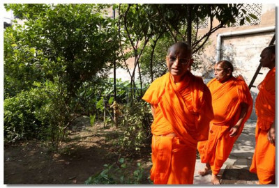 Acharya Swamishree Maharaj takes a walk in the Mandir gardens