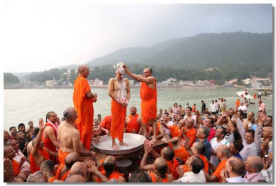 Acharya Swamishree is bathed by sants