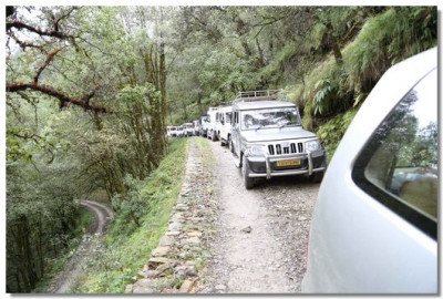 Convoy of jeeps take the pilgrims through the forests on Nainital