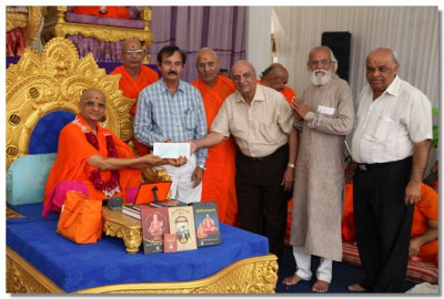 Charitable donations made by Acharya Swamishree Maharaj to various needy causes in the Panchmahal region