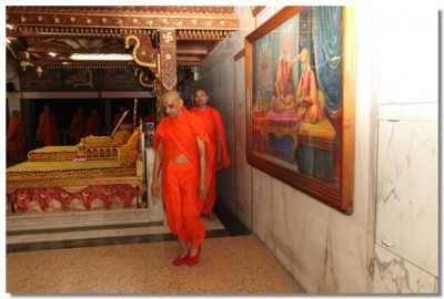 Acharya Swamishree and sants perform pradakshina in the Brahm Mahol of Shree Swaminarayan Temple Maninagar