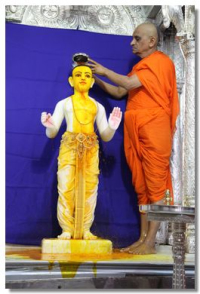 Lord Swaminarayan being bathed in saffron