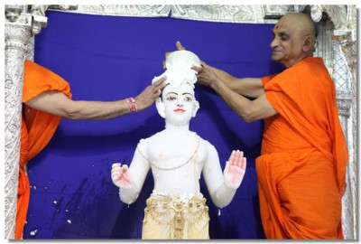 Lord Swaminarayan being bathed in yogurt
