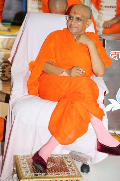 Acharya Swamishree watches the event