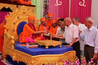 Acharya Swamishree Maharaj inaugurates a new kirtans CD 'Anand Mangal Thaye' which includes newly composed kirtans for Shree Swaminarayan Mandir Kingsbury Grand Opening festival in London