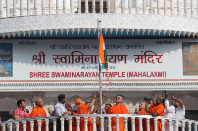 Acharya Swamishree raises the flag of India on Republic Day