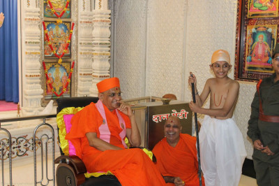 Acharya Swamishree watches young disciples performing sketches of key patriotic figures in the history of India
