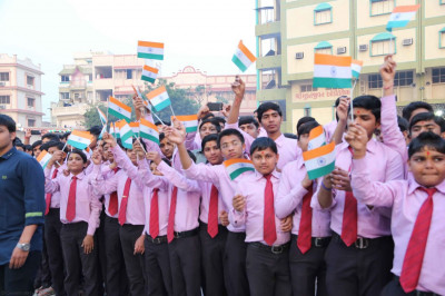 Students of the chhatralay wave the flag of India
