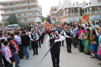 The band leads Acharya Swamishree around Maninagar Mandir compound