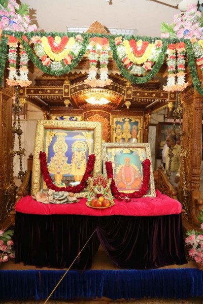 Divine darshan of the Murtis seated on a swing