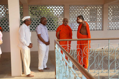Acharya Swamishree Maharaj in discussion with sants and disciples about the on going works in Bharasar