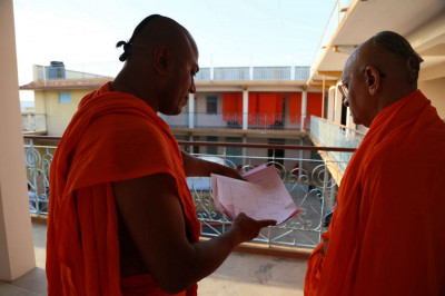 Acharya Swamishree Maharaj views the plans of the renovations