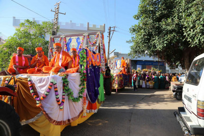 A procession from Mandir to the new temporary home for the Murtis