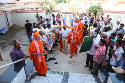 The procession arrives at the location where the Murtis will reside during the renovations