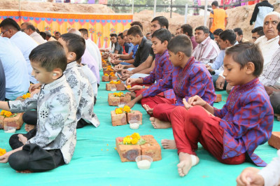 Disciples perform the poojan ceremony