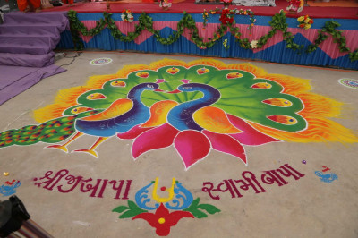 Rangoli decorations, prepared by disciples of Bharasar, along the path