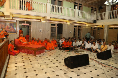 The performances are watched by Acharya Swamishree Maharaj, sants, and disciples