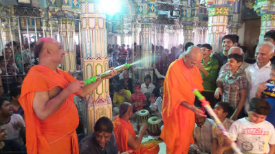 Sadguru sants spray coloured water onto disciples