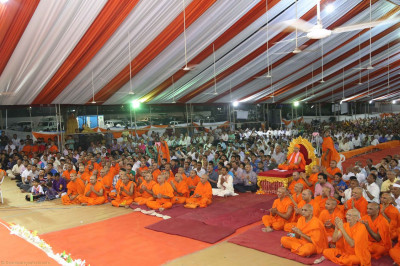 Acharya Swamishree, sants and disciples watch the performances