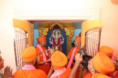 An aarti is performed during the installation ceremony