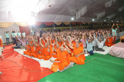 Sants and disciples sing the name of Lord Shree Swaminarayanbapa Swamibapa as the evening concert programme begins