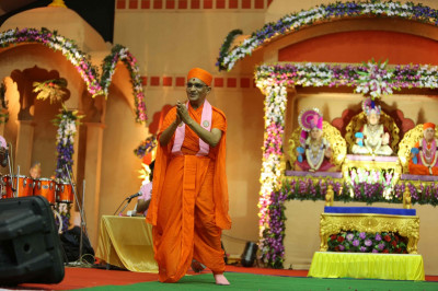 His Divine Holiness Acharya Swamishree dances on stage as Jeffrey Iqbal sings a devotional song