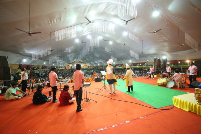 The view from the back of the stage as artists and famous singers perform devotional songs