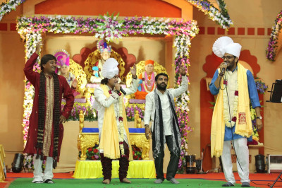 Singers dance as they sing traditional and modern devotional songs