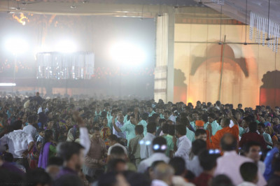 His Divine Holiness Acharya Swamishree walks around the whole concert hall blessing all as the evening concert continues