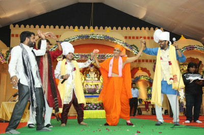 His Divine Holiness Acharya Swamishree dances on stage to a devotional song