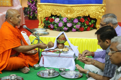Disciples who have sponsored the scripture recitals take part in the poojan ceremony