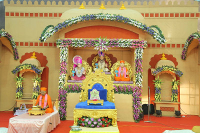 The full view of the charming stage decorated in the style of a village scene