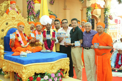 His Divine Holiness Acharya Swamishree officially releases the CD 'Smrutio Swamibapani' and presents to Sants and disciples