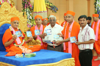 His Divine Holiness Acharya Swamishree officially releases the new DVD and presents to Sants and disciples