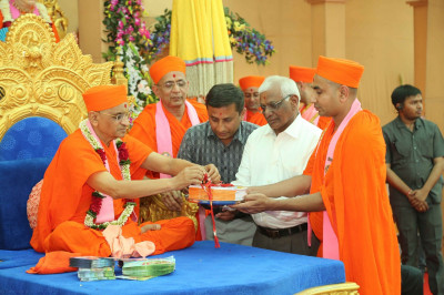 His Divine Holiness Acharya Swamishree releases the publication 'Khedanu Sahubhagya'