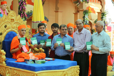 His Divine Holiness Acharya Swamishree releases the publication 'Santono Subodth' and presents to Sants and disciples