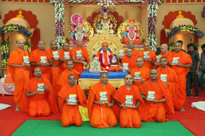 His Divine Holiness Acharya Swamishree presents the publication 'Khedanu Sahubhagya' to all Sants