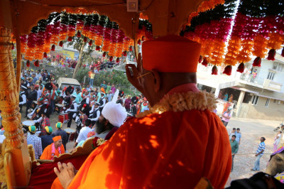 His Divine Holiness Acharya Swamishree blesses all during the grand procession