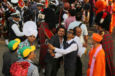 Disciples use a selfie stick with a mobile phone camera to capture and preserve fond memories of the grand procession