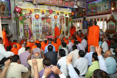 Disciples fill the small mandir hall during the ceremony