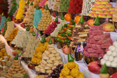 Various delicious sweet and savoury items presented to the Lord in the form of annakut