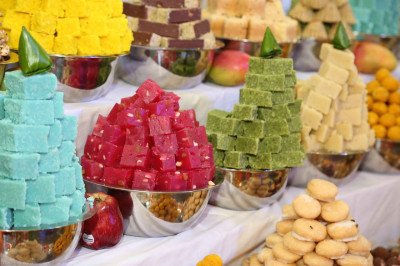 A close up of the many colourful sweet items prepared and presented to the Lord as part of the annakut