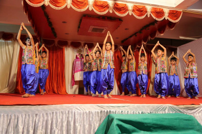 A devotional dance performance by young disciples