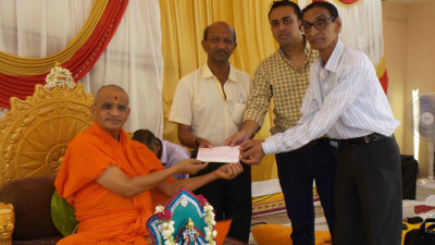 A donation is given to a needy cause in Kera
