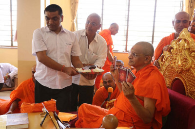 A new scripture is inaugurated by Acharya Swamishree