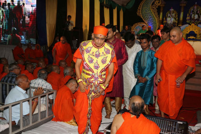 His Divine Holiness Acharya Swamishree enters the main area of the site of the evening performances in Maninagar mandir